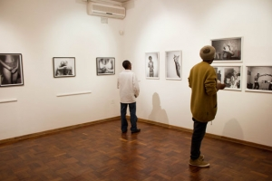 Viewers observing the displayed photographs during the exhibition opening